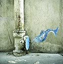 Small blue fish jumping into a pipe of street - Graph'wall - © Norbert Pousseur